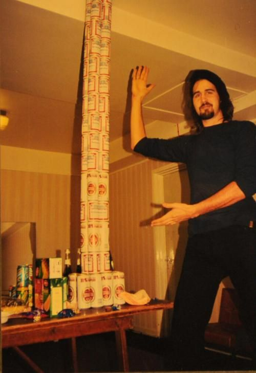 Krist Novoselic With A Long Stack Of Beer Cans